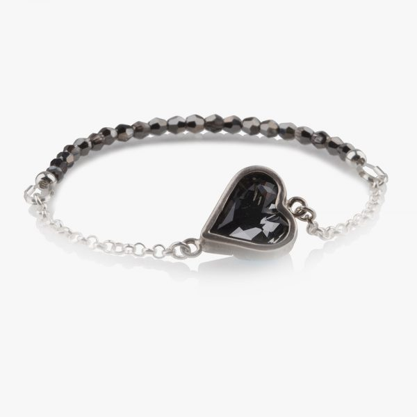 Beautiful handmade sterling silver bracelet with a dark grey crystal almost black (Kuro) and crystal beads on an elastic string. Easy to wear, due to the elastic string there isn't a clasp needed. Put it on and ready to go, no struggle with a clasp and no help needed to put it on. If the bracelet turns on your wrist then the crystal beads show beautifully.