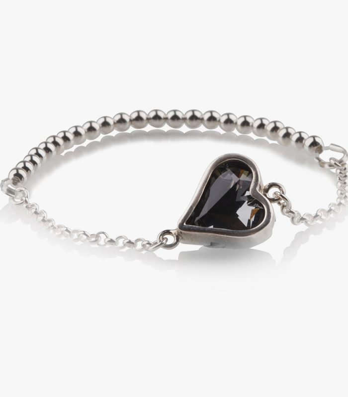 Beautiful handmade sterling silver bracelet with a dark grey almost black (Kuro) crystal and silver beads on an elastic string. Easy to wear, due to the elastic string there isn't a clasp needed. Put it on and ready to go, no struggle with a clasp and no help needed to put it on. If the bracelet turns on your wrist then the silver beads show beautifully.