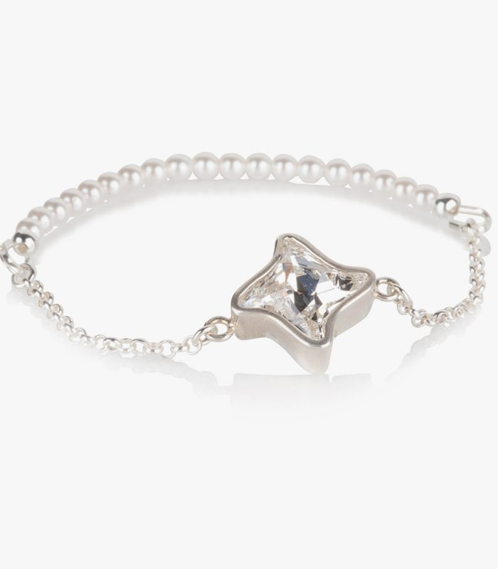 Beautiful handmade sterling silver bracelet with a white (Shiro) crystal and pearls on an elastic string. Easy to wear. If the bracelet turns on your wrist then the pearls show beautifully.