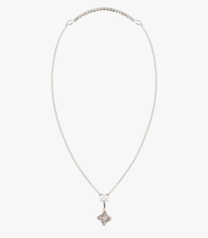 Beautiful handmade sterling silver necklace with a white crystal pendant, an Asian M hook clasp and sterling silver beads on elastic string.